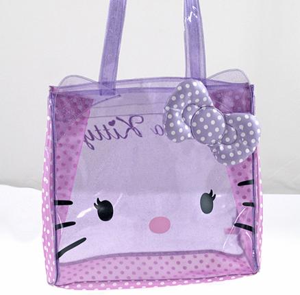Bolso cuadrado transparente de color lila con topos blancos mediano