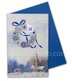 Felicitación de Navidad azul con adorno navideño