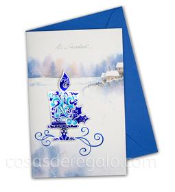 Felicitación de Navidad azul con una vela navideña