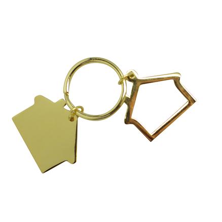 Llavero dorado con forma de casa